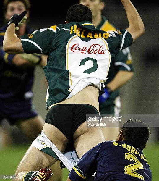 Joe Burgin for Ireland loses his shorts in a tackle from Chris Johnson for Australia during the second match of the International Rules series...