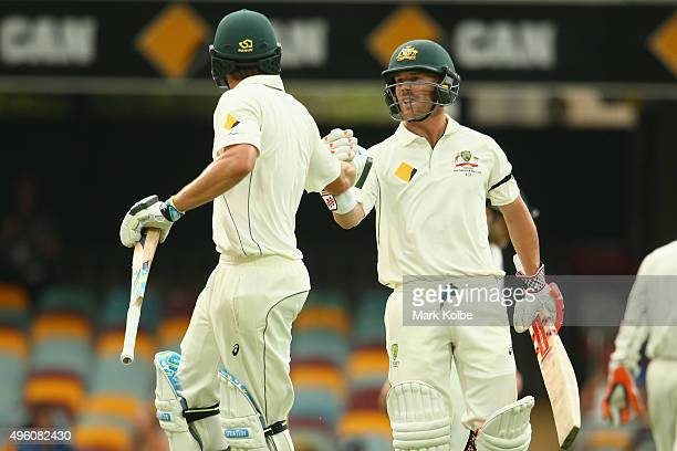 Joe Burns and David Warner of Australia celebrate their 200 partnership during day three of the First Test match between Australia and New Zealand at...