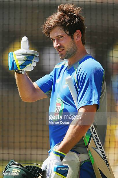 Joe Burns gives the thumbs up when coming back to the nets after being hit on the helmet by a Scott Boland delivery during an Australian nets session...