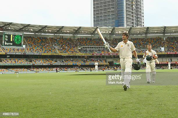 Joe Burns of Australia acknowledges the crowd as he leaves the field during a rain delay after reaching his century during day three of the First...