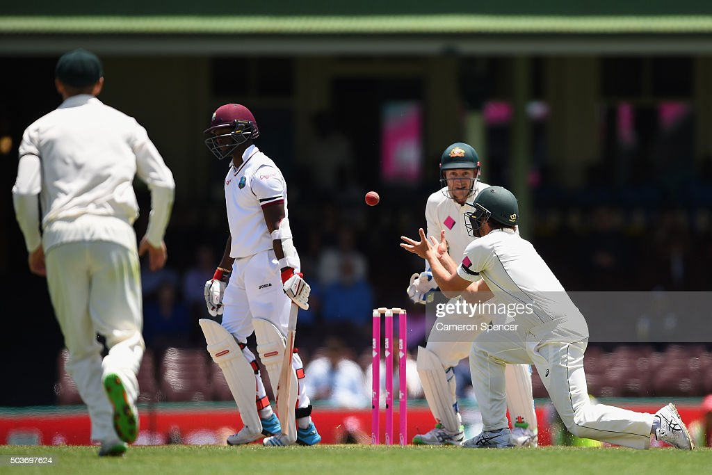<a gi-track='captionPersonalityLinkClicked' href=/galleries/search?phrase=Joe+Burns+-+Cricket+Player&family=editorial&specificpeople=15039111 ng-click='$event.stopPropagation()'>Joe Burns</a> of Australia catches <a gi-track='captionPersonalityLinkClicked' href=/galleries/search?phrase=Kemar+Roach&family=editorial&specificpeople=5408487 ng-click='$event.stopPropagation()'>Kemar Roach</a> of West Indies off a delivery by team mate <a gi-track='captionPersonalityLinkClicked' href=/galleries/search?phrase=Nathan+Lyon+-+Cricketer&family=editorial&specificpeople=11072184 ng-click='$event.stopPropagation()'>Nathan Lyon</a> of Australia during day five of the third Test match between Australia and the West Indies at Sydney Cricket Ground on January 7, 2016 in Sydney, Australia.