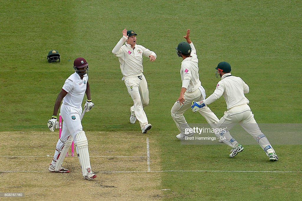<a gi-track='captionPersonalityLinkClicked' href=/galleries/search?phrase=Joe+Burns+-+Cricket+Player&family=editorial&specificpeople=15039111 ng-click='$event.stopPropagation()'>Joe Burns</a> of Australia celebrates taking a catch to dismiss <a gi-track='captionPersonalityLinkClicked' href=/galleries/search?phrase=Jason+Holder&family=editorial&specificpeople=6681136 ng-click='$event.stopPropagation()'>Jason Holder</a> of West Indies during day one of the third Test match between Australia and the West Indies at Sydney Cricket Ground on January 3, 2016 in Sydney, Australia.