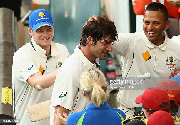Joe Burns of Australia is congratulated by Steve Smith and Usman Khawaja of Australia after he brought up his maiden test century during day three of...