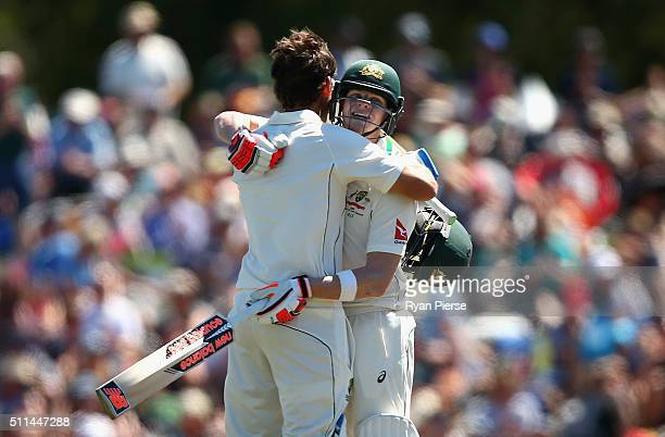 Joe Burns of Australia is congratulated by Steve Smith of Australia after reaching his century during day two of the Test match between New Zealand...