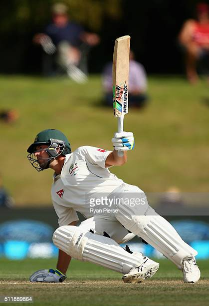 Joe Burns of Australia recovers after being hit on the helmet by a delivery from Neil Wagner of New Zealand during day five of the Test match between...