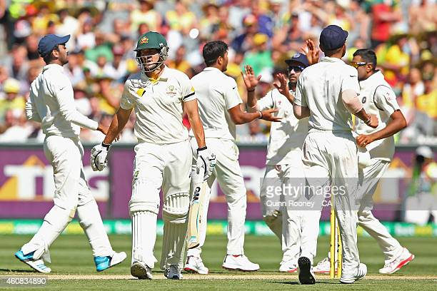 Joe Burns of Australia walks off the field after being dismissed by Umesh Yadav of India during day one of the Third Test match between Australia and...