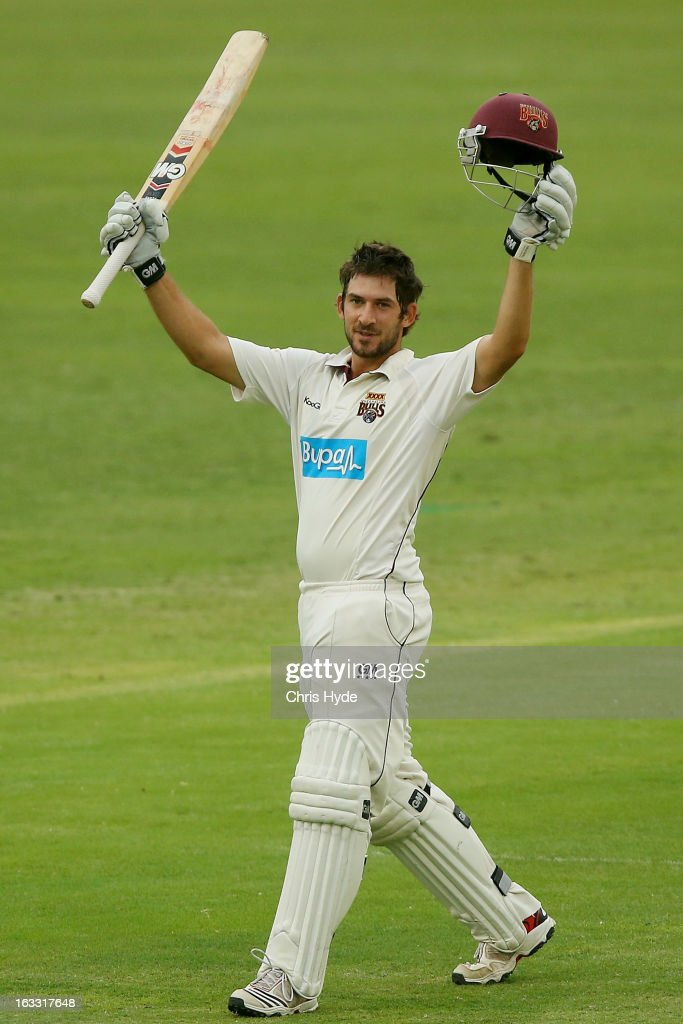 Joe Burns of the Bulls celebrates his century during day two of the Sheffield Shield match between the Queensland Bulls and the Tasmanian Tigers at The Gabba on March 8, 2013 in Brisbane, Australia.