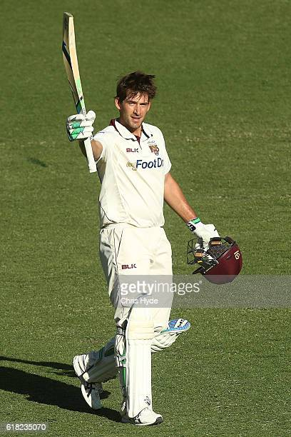 Joe Burns of the Bulls celebrates his century during day two of the Sheffield Shield match between Queensland Bulls and New South Wales Blues at The...