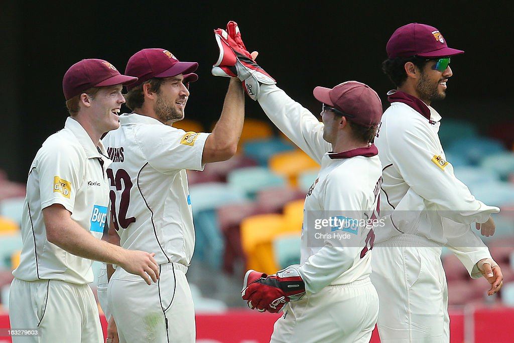 Joe Burns of the Bulls celebrates with team mates after taking a catch to dismiss Ricky Ponting of the Tigers during day one of the Sheffield Shield match between the Queensland Bulls and the Tasmanian Tigers at The Gabba on March 7, 2013 in Brisbane, Australia.