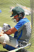 Joe Burns slumps to the ground after being hit on the helmet by Scott Boland during an Australian nets session at the Melbourne Cricket Ground on...