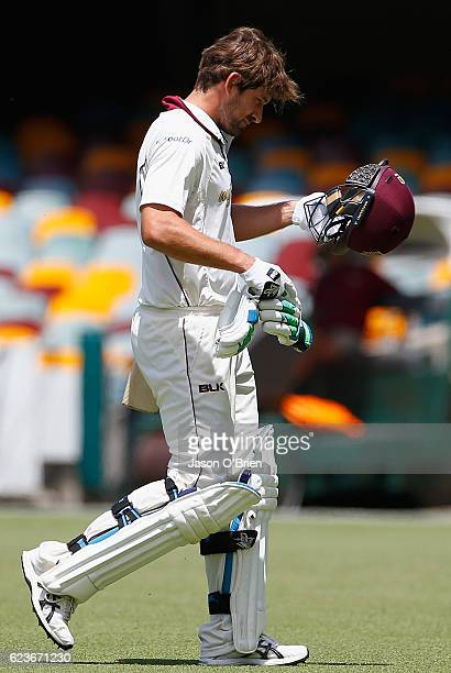 Joe Burns walks off after being dismissed during day one of the Sheffield Shield match between Queensland and South Australia at The Gabba on...