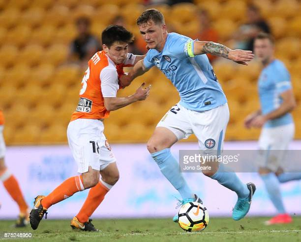 Joe Caletti of Brisbane and Michael Jakobsen of Melbourne contest the ball during the round seven ALeague match between Brisbane Roar and Melbourne...