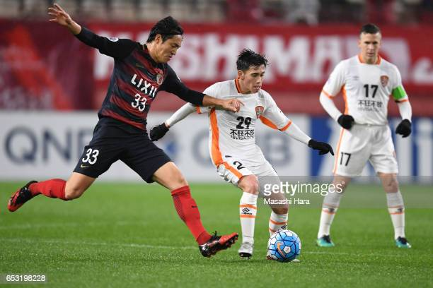 Joe Caletti of Brisbane and Mu Kanazaki of Kashima Antlers compete for the ball during the AFC Champions League Group E match between Kashima Antlers...