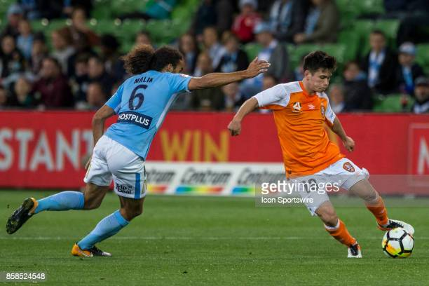 Joe Caletti of the Brisbane Roar passes the ball in front of Osama Malik of Melbourne City during Round 1 of the Hyundai ALeague Series between...