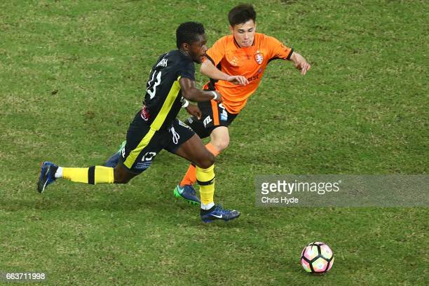 Joe Caletti of the Roar and Kwabena AppiahKubi of the Mariners compete for the ball during the round 25 ALeague match between the Brisbane Roar and...