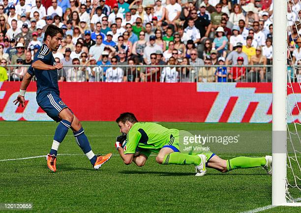 Joe Cannon of the Vancouver Whitecaps FC grabs the ball in front of Juan Pablo Angel of the Los Angeles Galaxy during their MLS game July 30 2011 at...