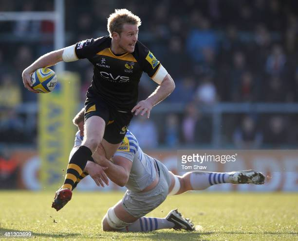Joe Carlisle of Wasps is tackled during the Aviva Premiership match between London Wasps and Saracens at Adams Park on March 29 2014 in High Wycombe...