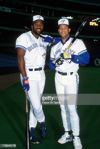 Joe Carter and Roberto Alomar of the Toronto Blue Jays poses together in this portrait prior to the start of a Major League Baseball game circa 1991...