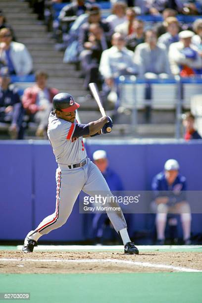 Joe Carter of the Cleveland Indians swings at the pitch during a 1987 game against the Toronto Blue Jays at Exhibition Stadium in Toronto Ontario...