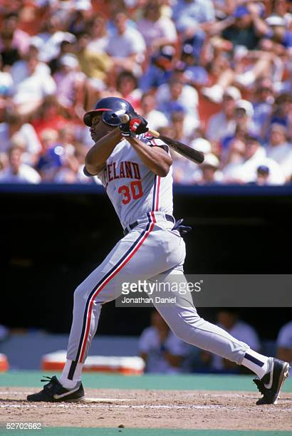 Joe Carter of the Cleveland Indians swings at the pitch during a 1989 game against the Kansas City Royals at Royals Stadium in Kansas City Missouri