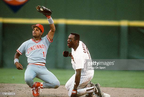 Joe Carter of the San Diego Padres is tagged out at second base by Barry Larkin of the Cincinnati Reds during an Major League Baseball game circa...