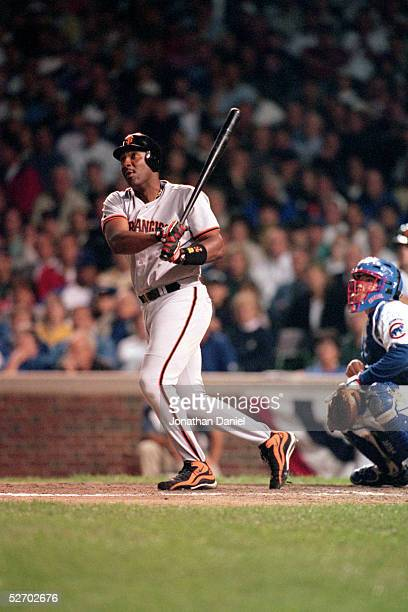 Joe Carter of the San Francisco Giants swings at the pitch during the game against the Chicago Cubs at Wrigley Field on September 28 1998 in Chicago...