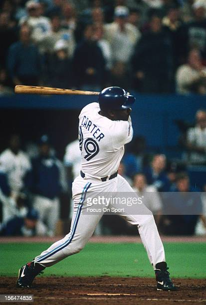 Joe Carter of the Toronto Blue Jays bats against the Philadelphia Phillie during game 6 of the World Series on October 23 1993 at Exhibition Stadium...