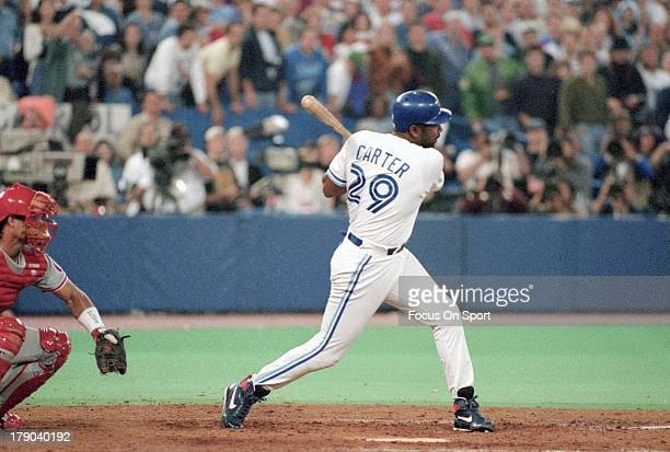 Joe Carter of the Toronto Blue Jays bats against the Philadelphia Phillies during game 6 of the World Series on October 23 1993 at Exhibition Stadium...