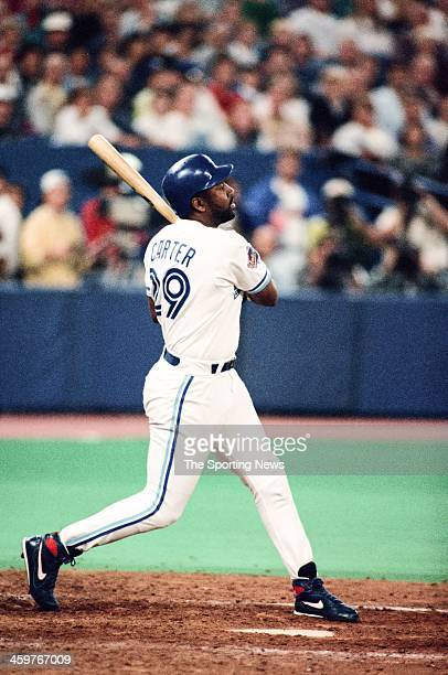 Joe Carter of the Toronto Blue Jays bats during a 1993 World Series game against the Philadelphia Phillies