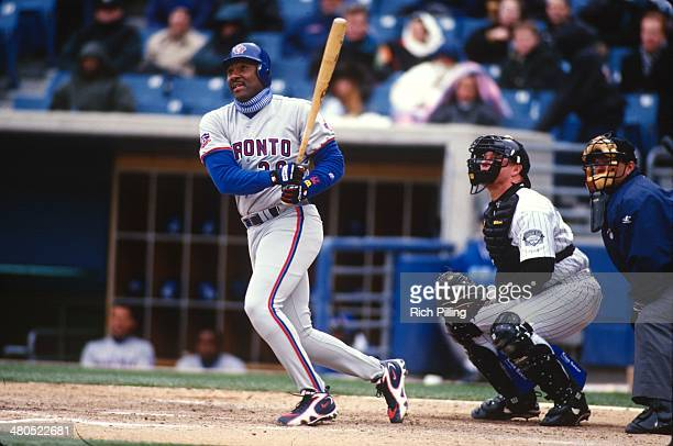 Joe Carter of the Toronto Blue Jays bats during the game against the Chicago White Sox at Comiskey Park on Thursday April 10 1997 in Chicago Illinois