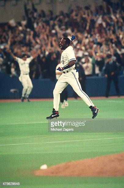 Joe Carter of the Toronto Blue Jays celebrates after hitting a walk off home run in the ninth inning during Game Six of the 1993 World Series at the...
