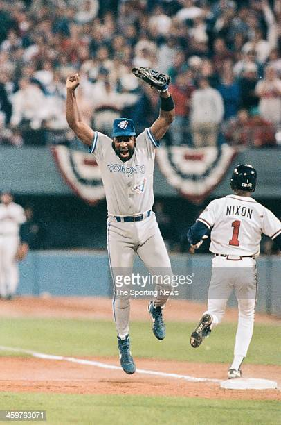 Joe Carter of the Toronto Blue Jays celebrates following a 1992 World Series game against the Atlanta Braves