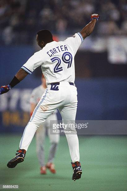 Joe Carter of the Toronto Blue Jays celebrates on the field during game six of the 1993 World Series against the Philadelphia Phillies at the Skydome...
