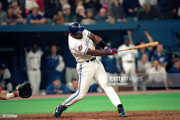 Joe Carter of the Toronto Blue Jays hits a game winning threerun home run against the Philadelphia Phillies in game six of the 1993 World Series at...
