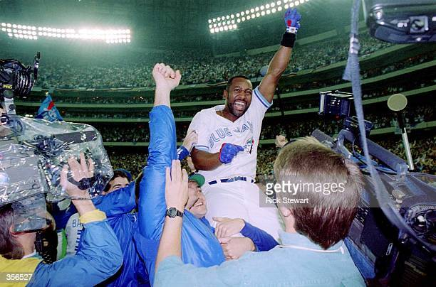 Joe Carter of the Toronto Blue Jays is held aloft after hitting a threerun homer in the bottom of the ninth to win the World Series four games to two...