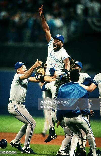 Joe Carter of the Toronto Blue Jays leaps in the air after the Blue Jays won World Series game two between the Atlanta Braves and Toronto Blue Jays...
