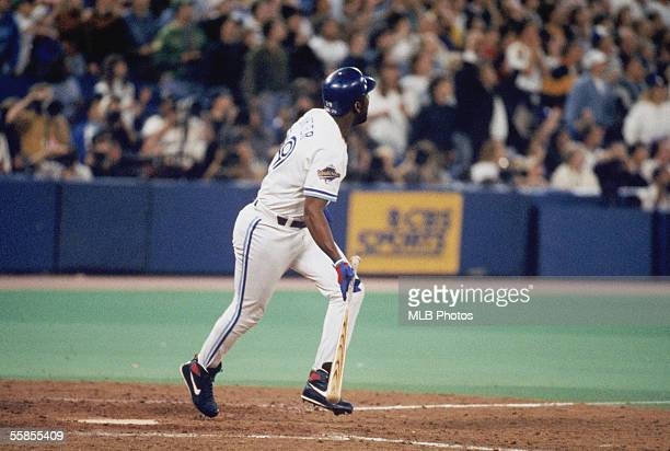Joe Carter of the Toronto Blue Jays makes a hit during game six of the 1993 World Series against the Philadelphia Phillies at the Skydome on October...