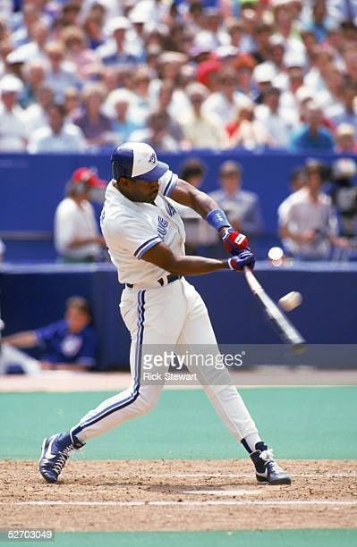 Joe Carter of the Toronto Blue Jays makes contact with a pitch during a 1991 game at Skydome in Toronto Ontario Canada