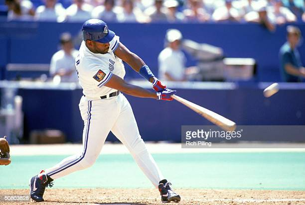 Joe Carter of the Toronto Blue Jays makes contact with the ball during a game on July 23 1994 at SkyDome in Toronto Ontario Canada