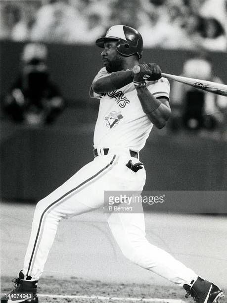 Joe Carter of the Toronto Blue Jays swings at a pitch during an MLB game circa 1992 at the Toronto Skydome in Toronto Ontario Canada