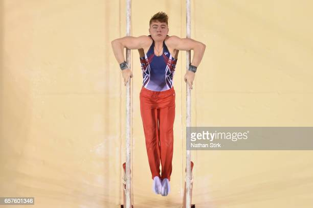 Joe CemlynJones of Falcons Gym Academy competes in the Parallel Bars during the British Gymnastics Championships at the Echo Arena on March 25 2017...