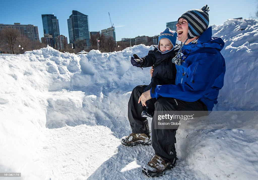 Joe Ciolino, of Boston, sat with his son John, 2, in a small fort built into the snow on Boston Common after a blizzard dropped over two feet of snow in the area, Sunday, Feb. 10, 2013.