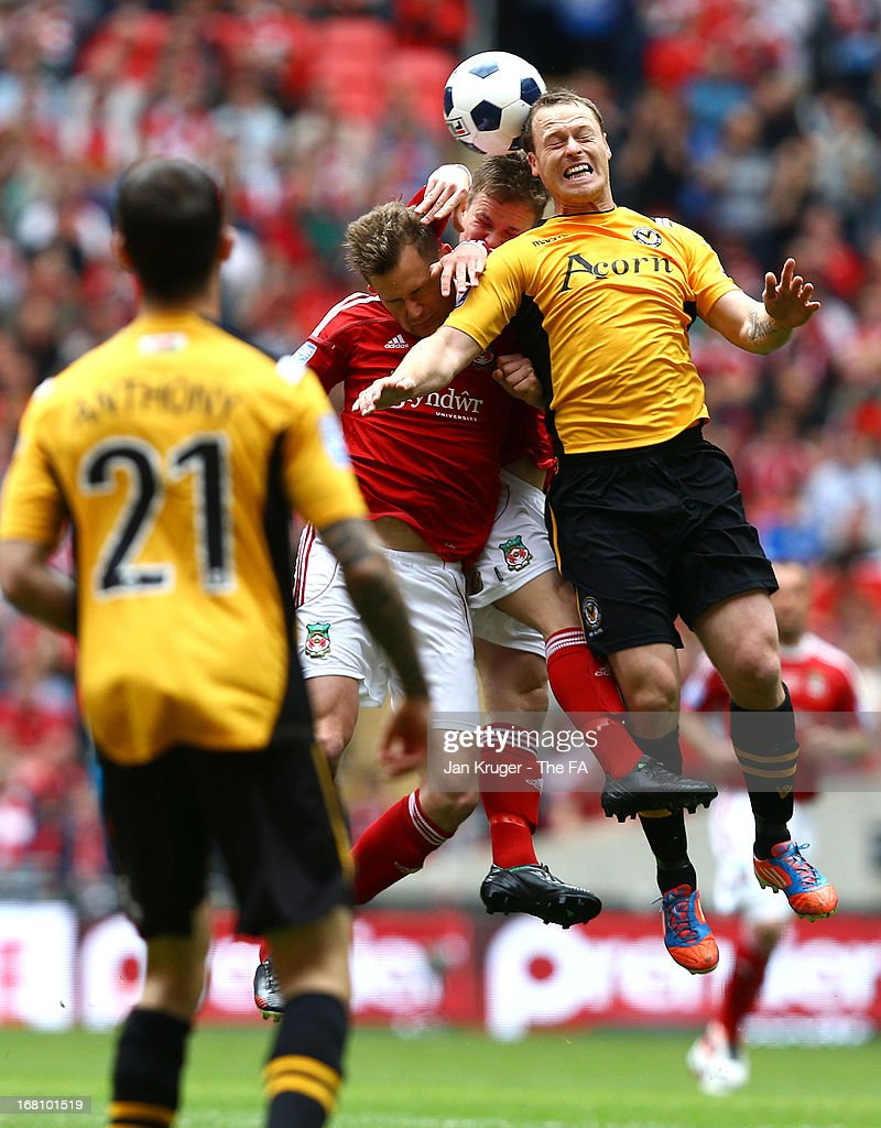 Joe Clarke and Dean Keates of Wrexham battles for the aerial ball with Michael Flynn of Newport County during the Conference Premier play-off final match between Wrexham and Newport County at Wembley Stadium on May 5, 2013 in London, England.