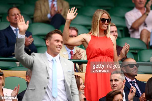 Joe Clarke and Saskia Clark are introduced to the crowd from the centre court royal box on day six of the Wimbledon Lawn Tennis Championships at the...