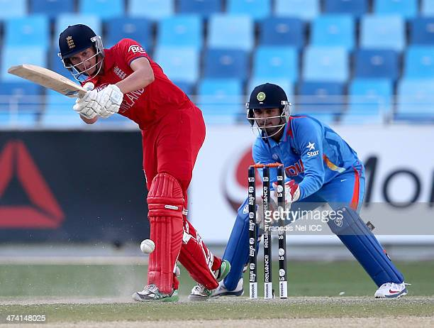 Joe Clarke of England bats as wicketkeeper Ankush Bains of India looks on during the ICC U19 Cricket World Cup 2014 Quarter Final match between...