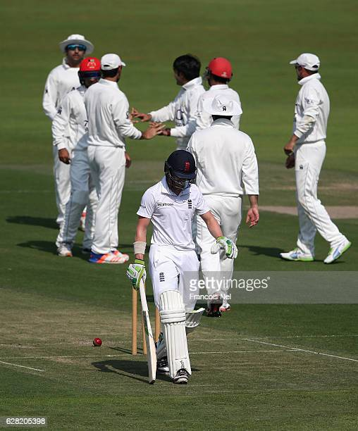 Joe Clarke of England Lions leaves the field after being dismissed by Rashid Khan of Afghanistan during day one of the tour match between England...
