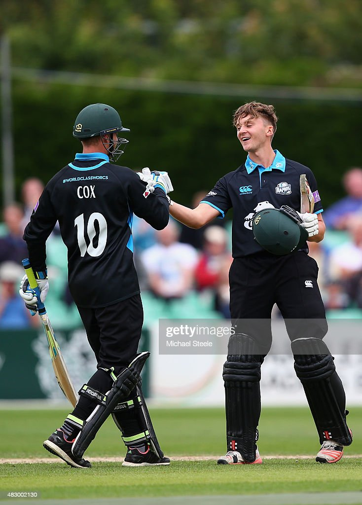 Joe Clarke of Worcestershire celebrates reaching his century with Ben Cox during the Royal London One Day Cup Group A match between Worcestershire...