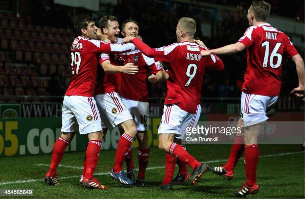 Joe Clarke of Wrexham AFC celebrates with team mates after scoring the first goal during the FA Cup Second Round match between Wrexham AFC and Oxford...