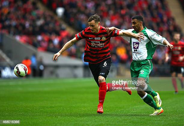 Joe Clarke of Wrexham looks to hold off Jason St Juste of North Ferriby during the The FA Carlsberg Trophy Final match between North Ferriby United...