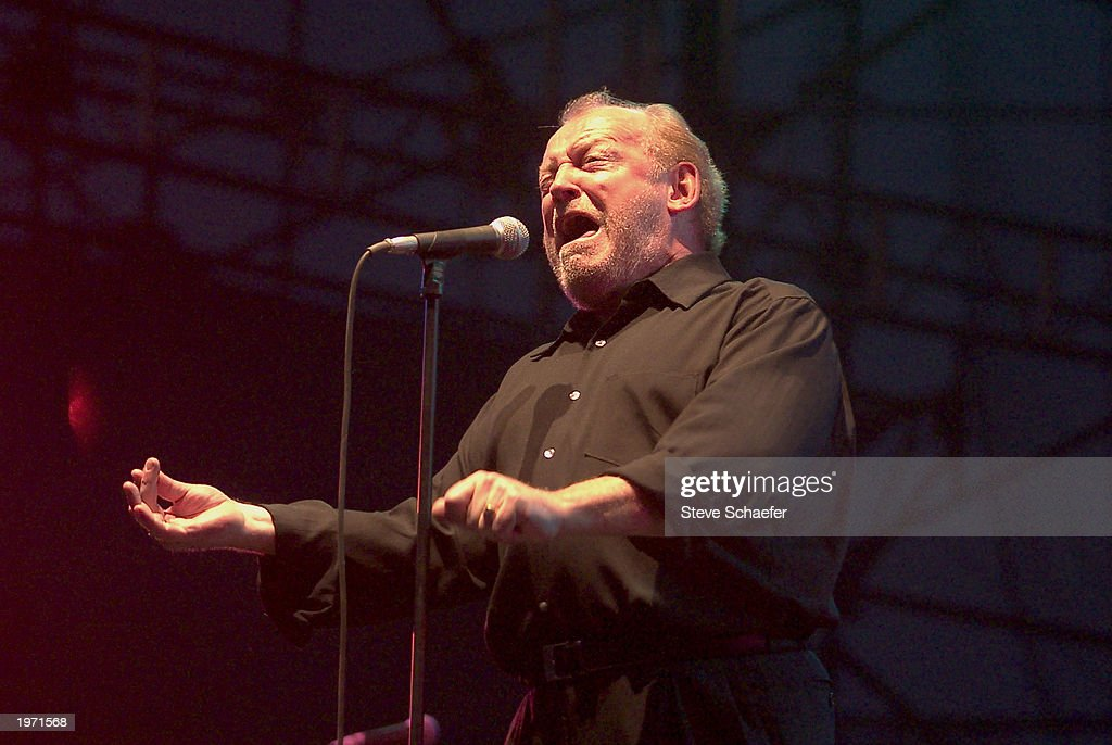 <a gi-track='captionPersonalityLinkClicked' href=/galleries/search?phrase=Joe+Cocker&family=editorial&specificpeople=159406 ng-click='$event.stopPropagation()'>Joe Cocker</a> performs May 3, 2003 during the Music Midtown concert in Atlanta, Georgia. The Music Midtown event features over 120 international, national and local musical acts performing on 11 stages over a 3-day period on a 40 acre complex.